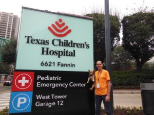 Alejandro and Hirschey in front of Texas Children's Hospital