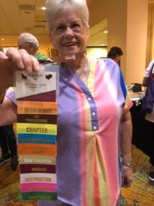 Carolyn Marr with badge ribbons at 2019 Conference