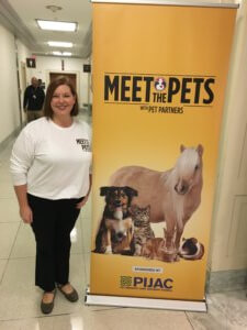 Mary Margaret Callahan with a Meet the Pets banner