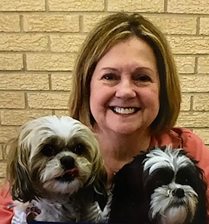 Mary Pecoul with her therapy shih tzus Abby and Bella