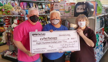 Jeff Manley and Jusak Yang Bernhard presenting a check to Ruth Olsen