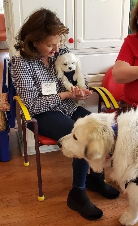 A therapy dog team during a visit
