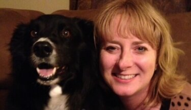 A border collie and his handler, both smiling