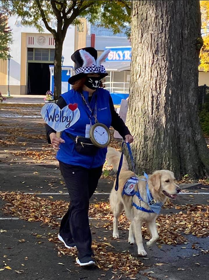 A costumed walker and dog taking part in The World's Largest Pet Walk